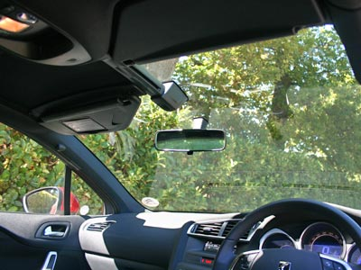 The windscreen extends far up into the roof. There are two sun screens and sliding panels.